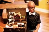 HANNAH SAYLE - Moziah Bridges displays his handmade bow ties.