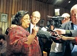 JACKSON BAKER - New county commissioner Edith Moore meets the media with backer George Flinn.