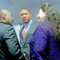 New Democratic chairman Bryan Carson (center) chatted with state Rep. G.A. Hardaway and asst. city attorney Regina Morrison Newman at post-convention reception.