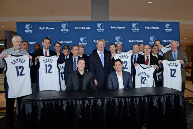New Grizzlies minority owners surround Pera and Levien at the end of the press conference