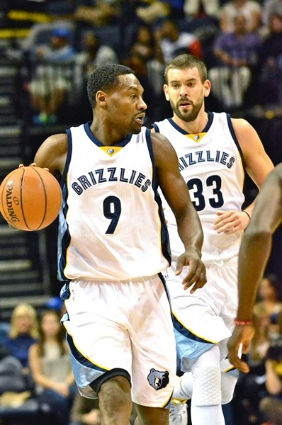 The Grizzlies' defense (left) and offense (right) both showed up big in Houston. - LARRY KUZNIEWSKI