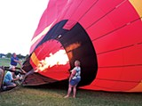 SHELBY BLACK - Organizers of the Balloon Bash fill a hot-air balloon.