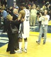 Owner Michael Heisley congratulates Rudy Gay after the Grizzlies win over Chicago.