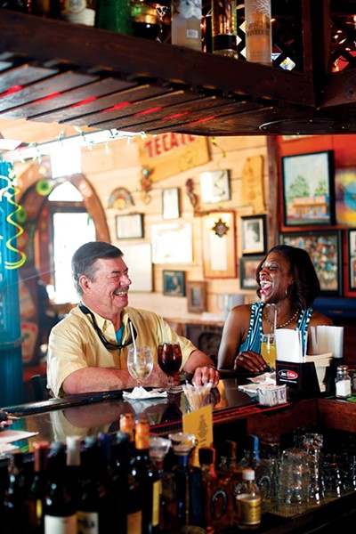 Phil Brown chats with Jackie, a fellow regular at Molly's La Casita. - JUSTIN FOX BURKS