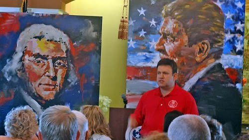 Pollster Luntz with portraits of Jefferson and Reagan