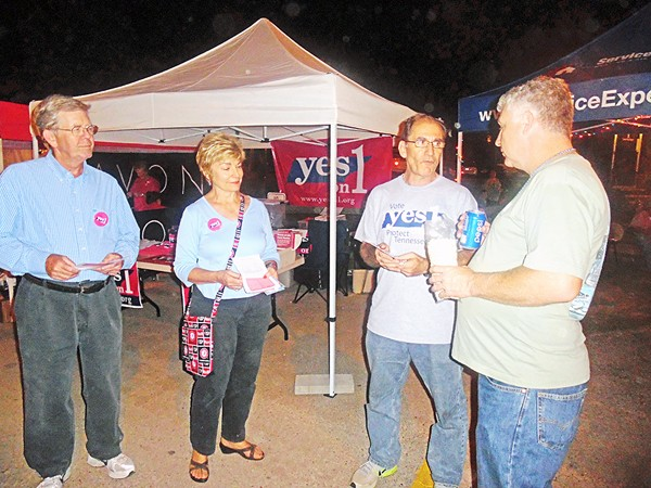 Proponents of Amendment 1 with passer-by at Bartlett Festival - JACKSON BAKER