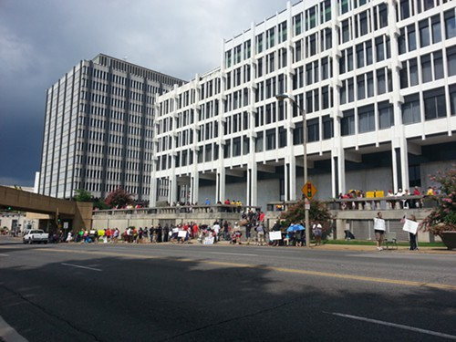 Protesters also gathered behind City Hall facing Front Street.