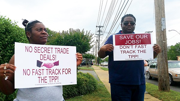 Protesters rally against the Trans-Pacific Partnership. - ALEXANDRA PUSATERI