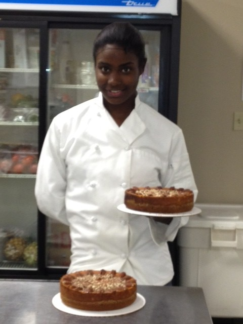 Eron Jackson, holding a cheesecake
