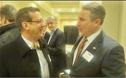 Rhodes College officials Bud Richey and Mike Palazzolo worked in a little shop talk at Caissa.