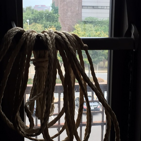 Rope hanging in a window