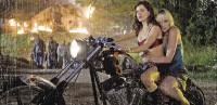 Rose McGowan drives Marley Shelton in Planet Terror