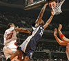 Rudy Gay dunks for two of his 16 points.