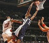 GETTY - Rudy Gay dunks for two of his 16 points.