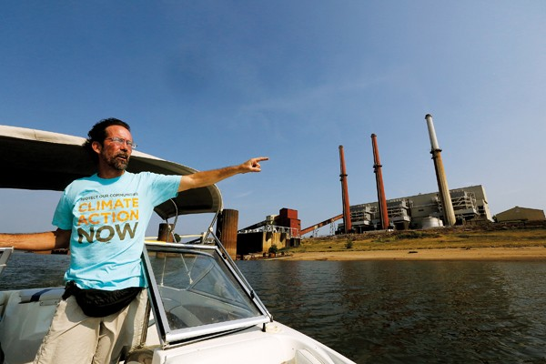 Scott Banbury, conservation program coordinator for the Tennessee chapter of the Sierra Club, points out the Allen Fossil Plant. - JUSTIN FOX BURKS