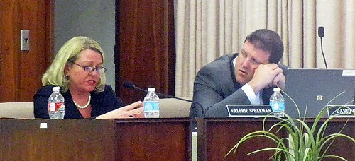 SCS attorney Valerie Speakman reads terms of agreement with Lakeland as board member David Reaves, who moved to accept it, listens.