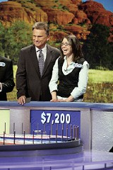 CAROL KAELSON - Seligstein with Wheel of Fortune host Pat Sajak