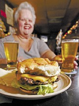 Shirley serves her burger at The Lamplighter Lounge