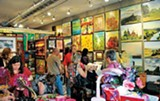 Shoppers browse  inside Painted Planet.