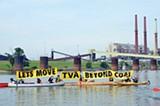 Sierra Club members unfurl banners at the TVA plant.