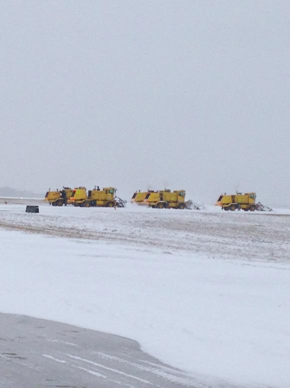 Crews work to de-ice a runway at Memphis International Airport. - MEMPHIS INTERNATIONAL AIRPORT