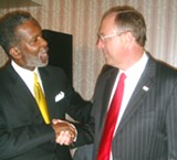 State Senate Democratic leader Jim Kyle of Memphis congratulates his party's new District 33 nominee, Reginald Tate.