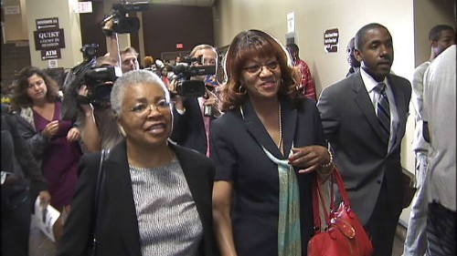 Still wearing the same odd smile she had when turning herself in Thursday night, Brooks, accompanied by an unidentified supporter (left) and her attorney, Andre Wharton, prepared to enter the courtroom of General Sessions Judge Bill Anderson, Jr.