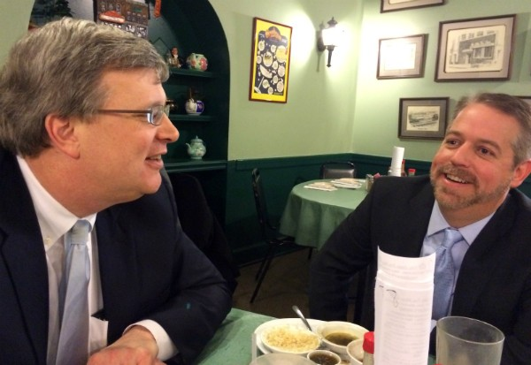 Strickland and campaign advisor Steven Reid discuss strategy at The Little Tea Shop in the wake of the Councilman's mayoral announcement Thursday. - JB