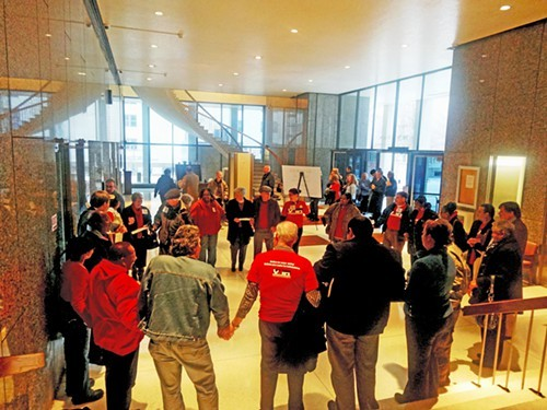 Supporters of a wage theft ordinance joined hands in prayer before the County Commissions fateful vote.