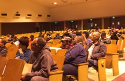 Supporters of South Side Middle gathered in the school's auditorium on Monday night to voice opposition to a plan to consolidate the school with Riverview Middle.