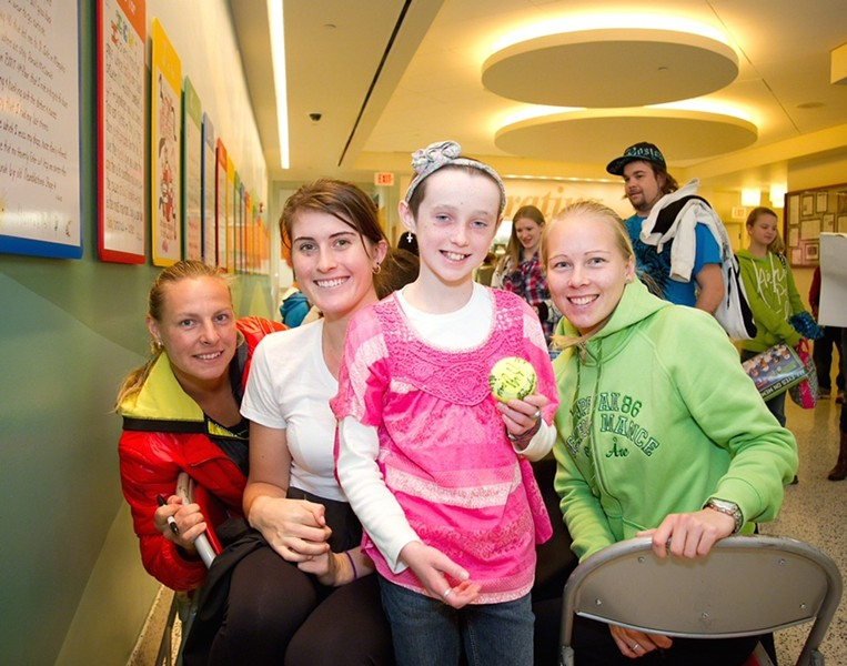 "Tennis players surround ""Maddie,"" a patient at St. Jude."