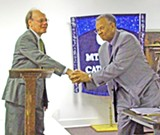JB - The congressman gets a handshake from NAACP president Dr. Warner Dickerson.