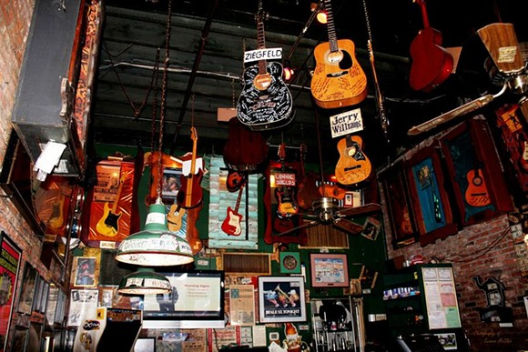 The hanging guitars at the Rum Boogie Cafe. - SUZANNE MCCLAIN