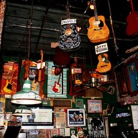 The hanging guitars at the Rum Boogie Cafe.