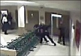 COURTESY OF MURRAY WELLS - The leaked video shows Bridges McRae repeatedly punching Duanna Johnson.