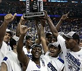 AP PHOTO - The Memphis Tigers celebrate winning the CUSA Tournament crown.