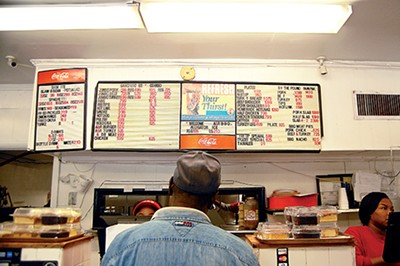 The menu board during lunch at A&R Bar-B-Que - TOBY SELLS