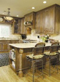 The perfect kitchen is both beautiful to look at and functional. Pictured is a kitchen designed by Eileen Henry of Kitchens Unlimited