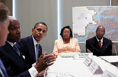 The President listens as Mayor Wharton lays out facts during flood meeting. - WH
