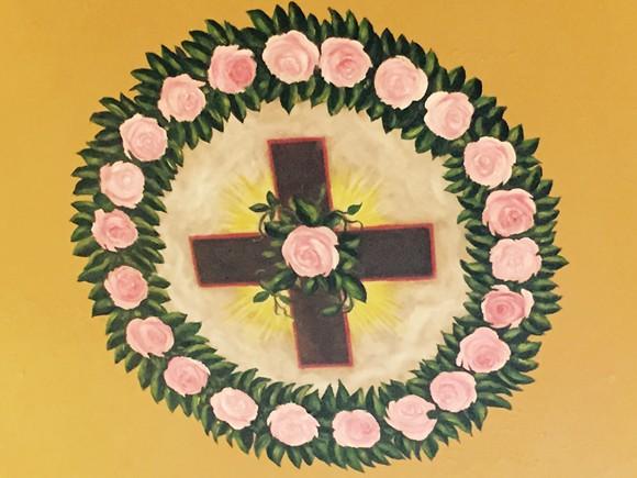 The rose cross.
