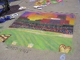 MICHAEL FLANAGAN - The team from Fleming Associates took Best in Show for their chalk drawing of AutoZone Park