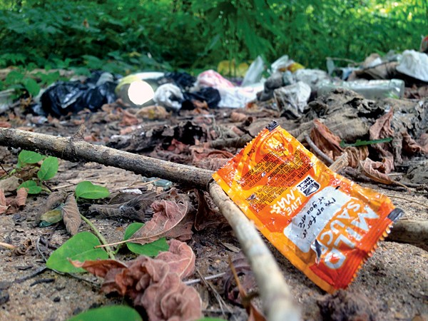 Trash lingers at a dead end street in Northaven where hidden cameras caught an illegal dumper last week.