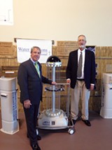 TRU-D president Chuck Dunn and inventor Jeffrey Deal with a germ-killing robot.
