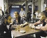 True grit: Farrell (center) and Foxx (right) in Miami Vice