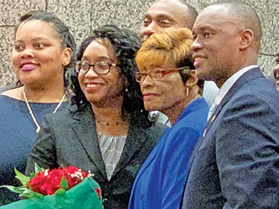 Newly named Shelby County Public Defender Phyllis Aluko, flanked by her mother and members of the Shelby County Commission. - JACKSON BAKER