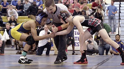 Jailen Young (left) faces off against an opponent in Wrestle.