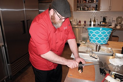 Aaron Winters relaxes by going - to work in the kitchen. - MICHAEL DONAHUE