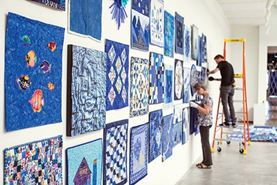 """""""Blue: A Regional Quilt Challenge,"""" curated by Paula Kovarik, is on display at Crosstown Arts."""