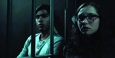 Michael Garza (left) and Zoe Margarett Coletti star in Scary Stories to Tell in the Dark.