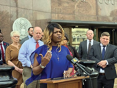 Kayla Gore speaks at a news conference in April. - LAMBDA LEGAL